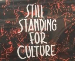 """Klistermärke med texten """"STILL STANDING FOR CULTURE""""."""